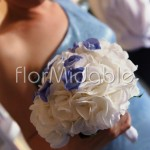 White hydrangea hand tied bouquet with an elegant blue touch