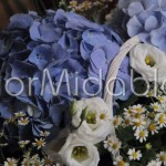 Blue hydrangeas, white lisianthus and chamomile flowers